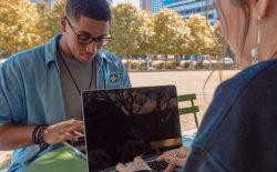 people working at laptop